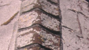 Worn out roof shingles